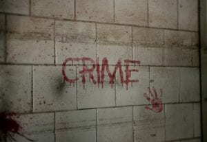 crime written on wall and hand stained