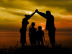 parents with their two children at the sunset