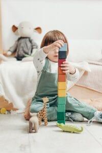 child playing lego blocks