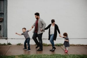 family walking at the street
