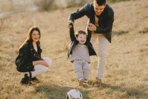 family having fun with soccer ball